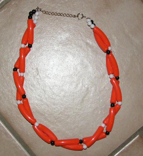 Orange plasthalsband.