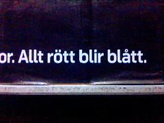 Annonstavla med texten 'Allt rött blir blått'