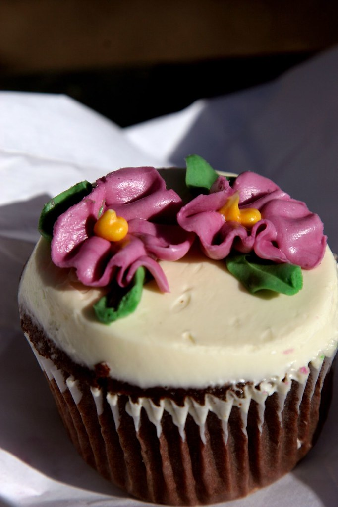 39th St Cupcake Cafe Bakery Chocolate with White Frosting and Flowers Cupcake