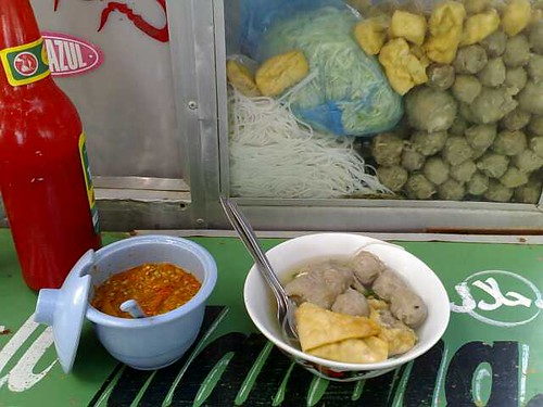 A bowl of bakso with an extra egg too