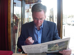 Doug Reads the Paper During Petit-Dejeuner