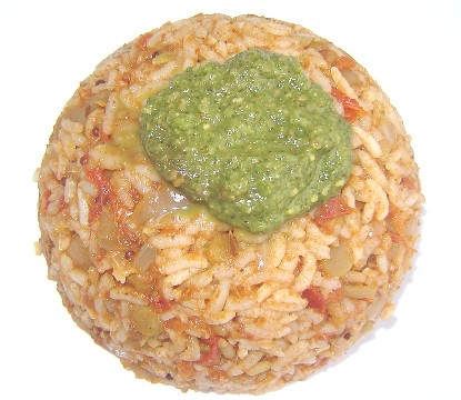 Tomato rice with a dollop of mint chutney