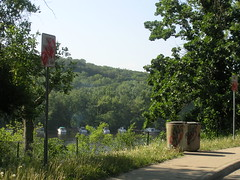 Graffiti covers signs and garbage cans at the Stillwater Boomsite Rest Area, ...
