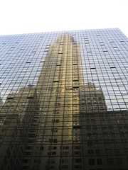 The Chrysler Building reflected in the building across the street