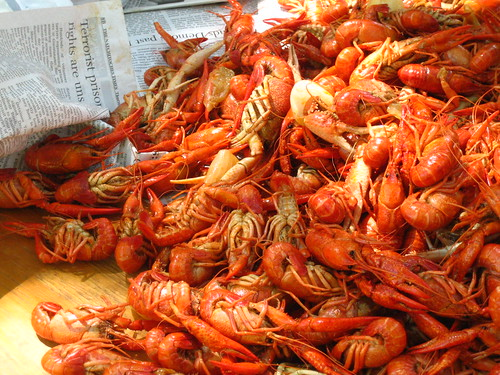 Pile of crawfish on newspapers