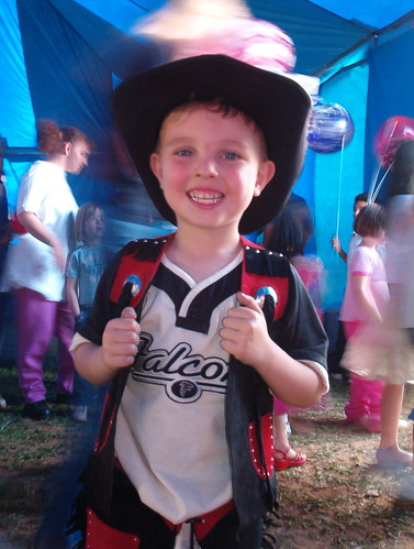 cowboy kid happy at the circus