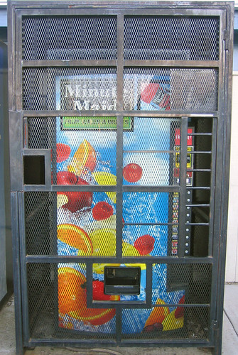 Caged Soda Machine
