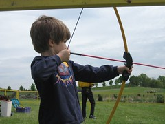 Kyle tries his luck with the bow and arrow