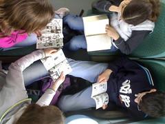 quattro lettori in treno