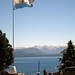 View of lake from plaza, Bariloche, Argentina, with national flag