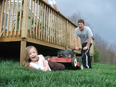 yes, it's my brother trying to run over my dear sweet neice elora with a lawnmower.