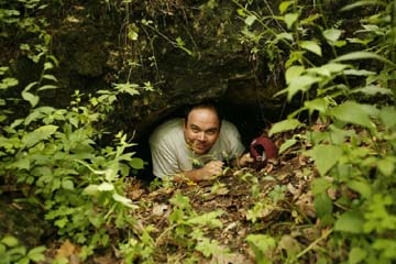 Michael Carter looking out of the entrance to Paul-Petroske Cave