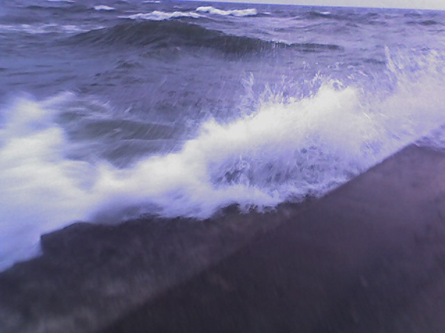 water coming over the edge of the grand haven pier - heavy seas 1
