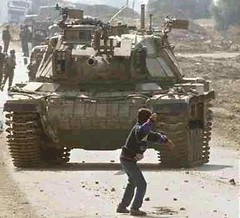 Israel Palestinians kid against tank
