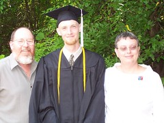 the grad and his parents