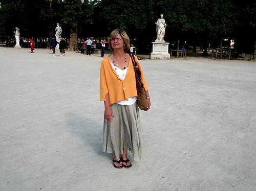 a beauty among statues