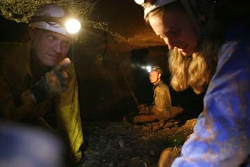 Hans Bluedorn talking with Johannah Bluedorn on ledge in Mushroom Cave
