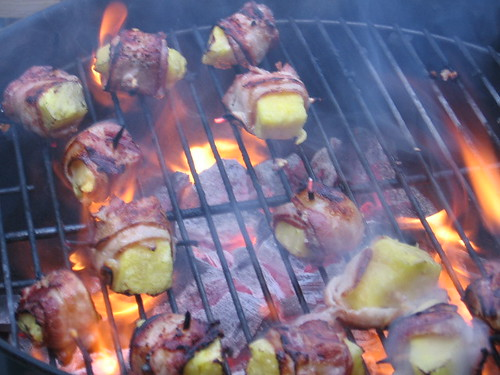 bacon wrapped pineapple on fire