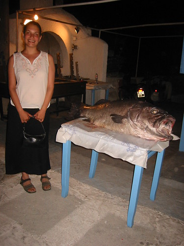 Posing with a fish (and filthy feet)
