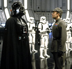 Darth Vader conducting a status meeting.