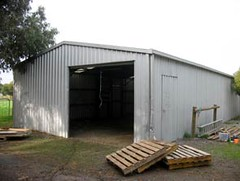 The shed stands
