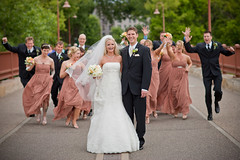 Wedding party rush at Stone Arch Bridge - by Matt photo by Camelot Photography Minnesota