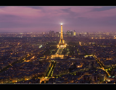 Paris skyline at night with Eiffel tower photo by Dutch Dennis