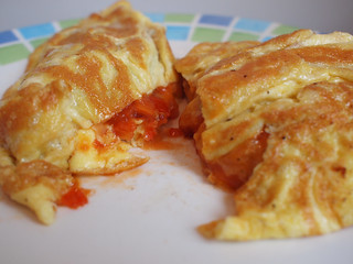Hot cheese omelette with spicy tomato salsa