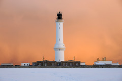 Approaching snowstorm at Girdle Ness lighthouse, Aberdeen, Scotland photo by iancowe