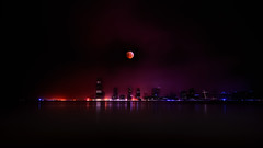 The 2010 Winter Solstice Lunar Eclipse over Jersey City, NJ photo by mudpig