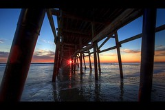 sunset through the pier photo by Eric 5D Mark III