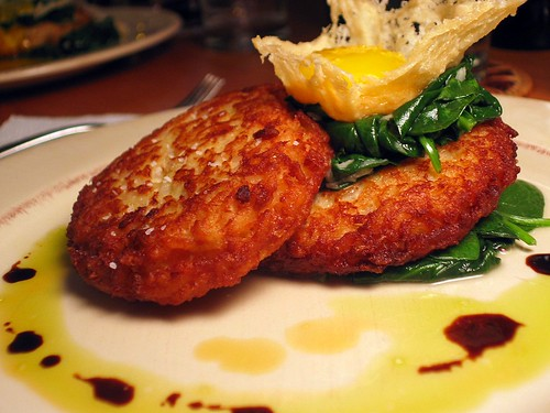 Radicchio Risotto Cakes with Egg Yolk in Crispy Cheese and Sauteed Spinach