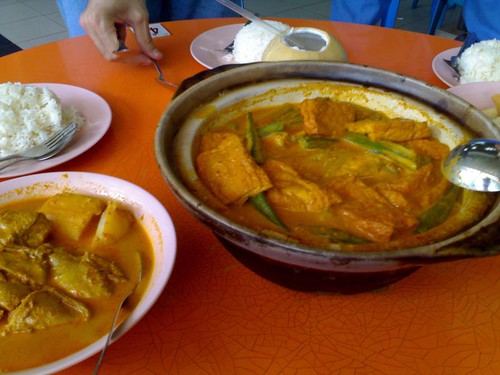Fishhead curry and some chicken curry on the side