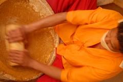 Making Hindu Head Dot Powder, Jaisalmer, Rajasthan, India Captured April 14, 2006.