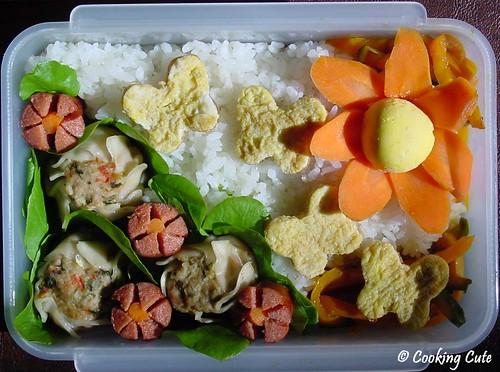 [bento with egg butterflies, hotdog flowers, carrot sun]