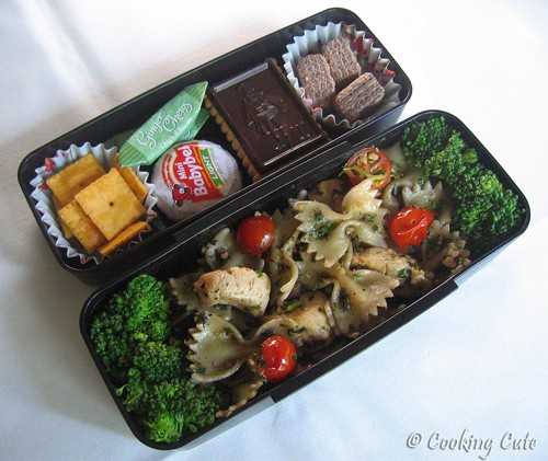 [big bento with chicken pasta salad and tier of snacks]