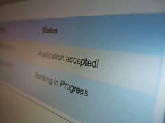 "Photo of an LCD showing the SoC web app: ""Application accepted!"""