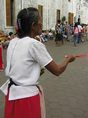 A candle vendor dances the Sinulog