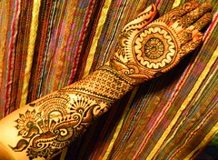 Elaborate henna on arm and palm of hand photo by Volcano Henna