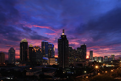 Jakarta under the sunset sky photo by Sayid Budhi