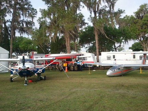 The CAP static display area at 2011 Sun-n-Fun in Lakeland, FL, with a new Cessna 182T, a xxx L23 glider, comm trailer, command trailer, and FEMA trailer.