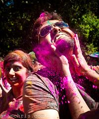 purple holi powder applied to a beard very diliberately photo by tibchris
