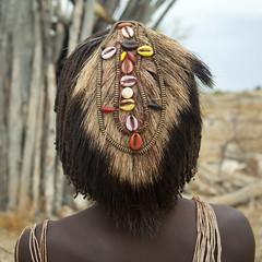 Mucubal girl hairstyle - Angola photo by Eric Lafforgue