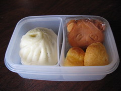 [snack bento with steamed bun and panda cake]