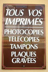 Sign on the wall outside a French print-products shop