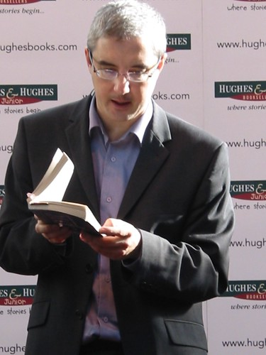 Conor Kostick doing a book reading at Hughes and Hughes