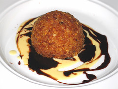 Candied Macadamia Nut Bombe with Dark Chocolate Sauce