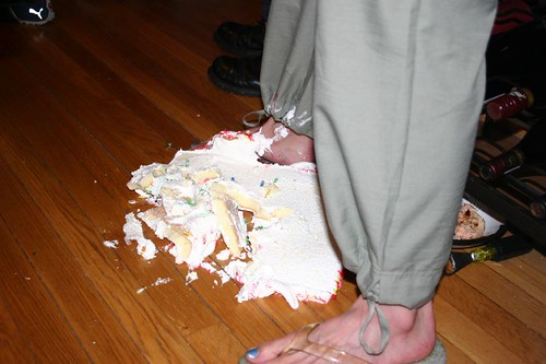 cake on floor and foot