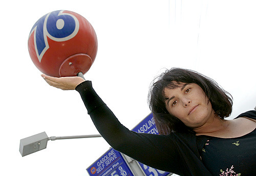 Kim Cooper and endangered 76 ball by Ricardo DeAratanha