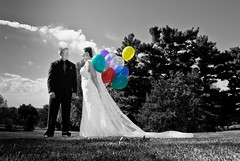 bride & groom with colorful balloons photo by laughlinc